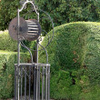 Stock Photo: Well in cured Italian-style garden of villof late sevent