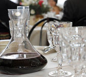 Decanter with wine in a table with glass of fine Bohemian glassw — Stock Photo