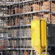 Big yellow silo to contain water and scaffold building — Stock Photo