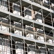 Scaffold building for the construction of buildings in the const — ストック写真