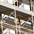 Scaffold building for the construction of buildings in the immen — ストック写真