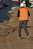 Worker with high visibility jacket as personal protective equip — Stock Photo