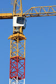 Cranes with the cockpit with the background of a blue sky shinin — Stock Photo