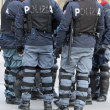Policemen with bullet-proof jacket and the baton — Stockfoto