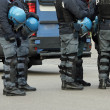 Stock Photo: Policemen with bullet-proof jacket and blue helmet during re