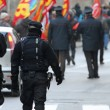 Armed police and riot gear escorted the procession of protesters — Stockfoto