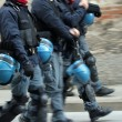 Policemen with blue helmet running — Stock Photo