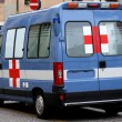 Ambulance van of police and Red Cross parked on the street — Stock Photo