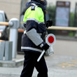 Stock Photo: Policewomwith paddle while directing traffic