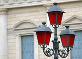 Historical lantern with Christmas red glass for street furniture — Stock Photo