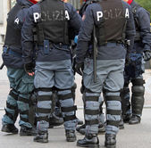 Policemen with bullet-proof jacket and the baton during the revo — Stock Photo