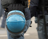 Italian police helmet blue ready to be worn during a demonstrati — Stock Photo