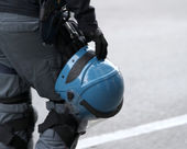 Police helmet hanging from the waistband of the policeman — Stock Photo