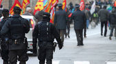 Armed police and riot gear escorted the procession of protesters — Stock Photo