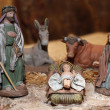 Nativity scene with Jesus, Joseph and Mary in a manger on Christ — Stock Photo