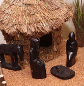 Nativity set in an village with wooden figurines 2 — Stock Photo