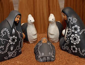 Nativity scene with characters dressed in black — Стоковое фото