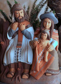 The Holy family with clothes Bolivians with cloak 1 — Stock Photo