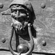 Bronze door knockers with a face to knock — Stock Photo