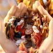 Crib with the Nativity baby Jesus in the hands — Stock Photo