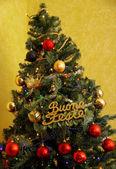 Christmas tree with written happy holidays — Stock Photo