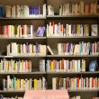 Stock Photo: Books in municipal library for consultation of educated reader
