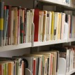 Stock Photo: Many books and essays in municipal library available to educat