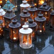 Stock Photo: Lantern resting on road during votive prayer ceremony in