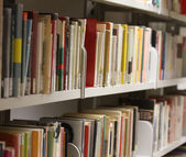 Many books and essays in a municipal library available to educat — Stock Photo