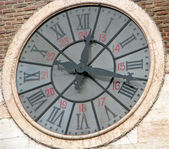 Ancient clock with Roman numerals — Stock Photo