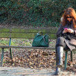 Womon bench while using your mobile phone — Stock Photo #38859923