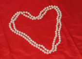 Elegant Pearl Necklace in the shape of a heart — Stock Photo