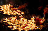 Many wax candles lit by the faithful during the celebration of t — Stock Photo