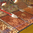 Stock Photo: Almonds and almond and sugary sweets for sale in candy store