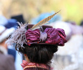 Elegant lady hat adorned with a feather of a pheasant — Stock Photo
