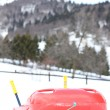 Stock Photo: Red bob made of plastic on white snow for fun rides on  moun