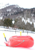 Red bob made of plastic on white snow for fun rides on the  moun — Photo