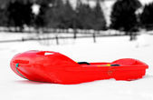 Red bob made of plastic on white snow — Stock Photo