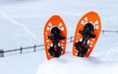 Isolated snowshoes for walking on the snow on the high mountain  — Stock Photo