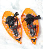 Orange snowshoes for walking on the soft snow — Stock Photo