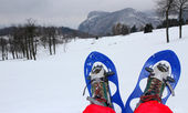 Rest after a long walk with snowshoes in the mountains — Stock Photo