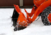 Snowplow at work to clear the road from the snow — Stock Photo