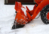 Snowplow at work to clear the road from the fresh snow — Stock Photo