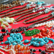 A lots of jewelry and gemstone necklaces for sale at a jewelry s — Stock Photo