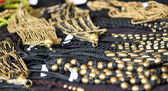 Jewelry and precious for sale by antique jeweler — Stock Photo
