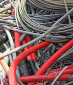 Obsolete electrical cables and copper cables in a container for  — Stock Photo