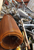 Old net and other rusted iron material in a container — Stock Photo
