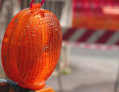Lit lamp for the roadworks as distress signal — Stock Photo