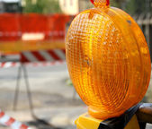 Orange lit the lamp for the roadworks — Stock Photo