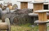 Wooden reels deposit for electric cable — Stock Photo